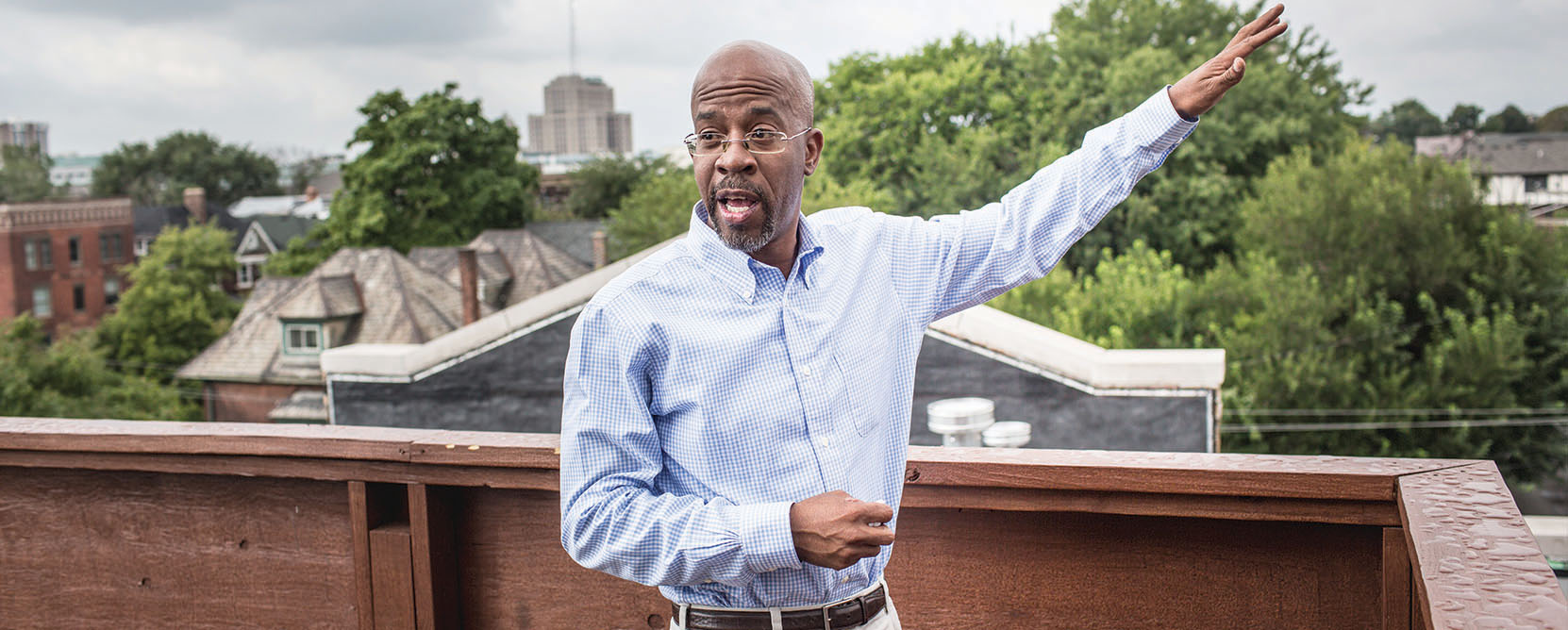 Richard Hosey poses on rooftop of building