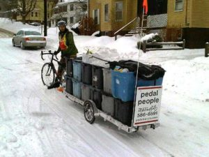 USFCW-member Pedal People hauls trash and recycling and delivers farm shares by bike in MA. Photo courtesy of Maureen Flannery.