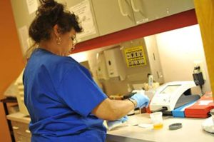 Tri-City staff member works with medical samples