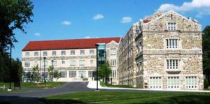 A view of the stone buildings and red roof of St. Paul's School in Washington, DC