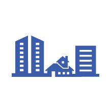 Icon showing three buildings of various sizes and types making up a community