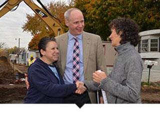 New cooperative homeowners shake hands
