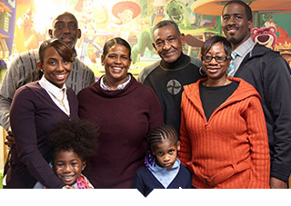 Minority cooperative business owners stand for group photo