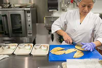 Preparing quesadillas for meal delivery