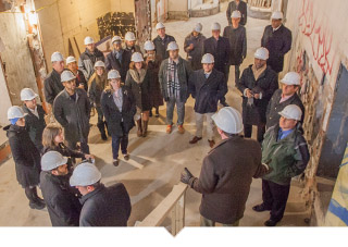 Capital Impact Staff give tour of construction site to group of individuals