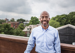 Detroit developer Richard Hosey poses on rooftop