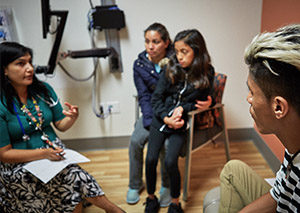 Doctor meets with family at community health center.