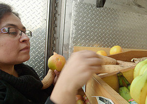 Woman shops at mobile farmers market