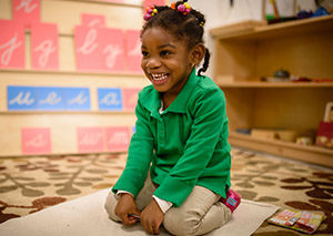 Charter elementary school student plays in her classroom