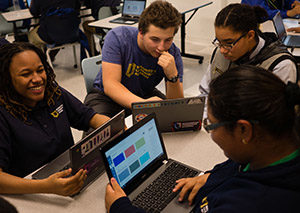 Group of charter high school students work on their laptops.