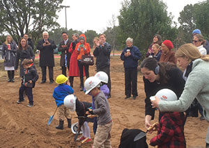 Small kids use shovels to celebrate groundbreaking of Montessori for All's new building