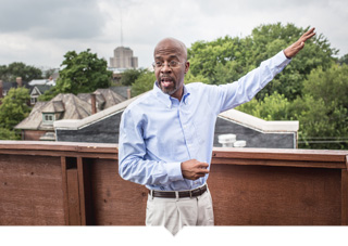 Richard Hosey stands on the rooftop of one of his Detroit projects.