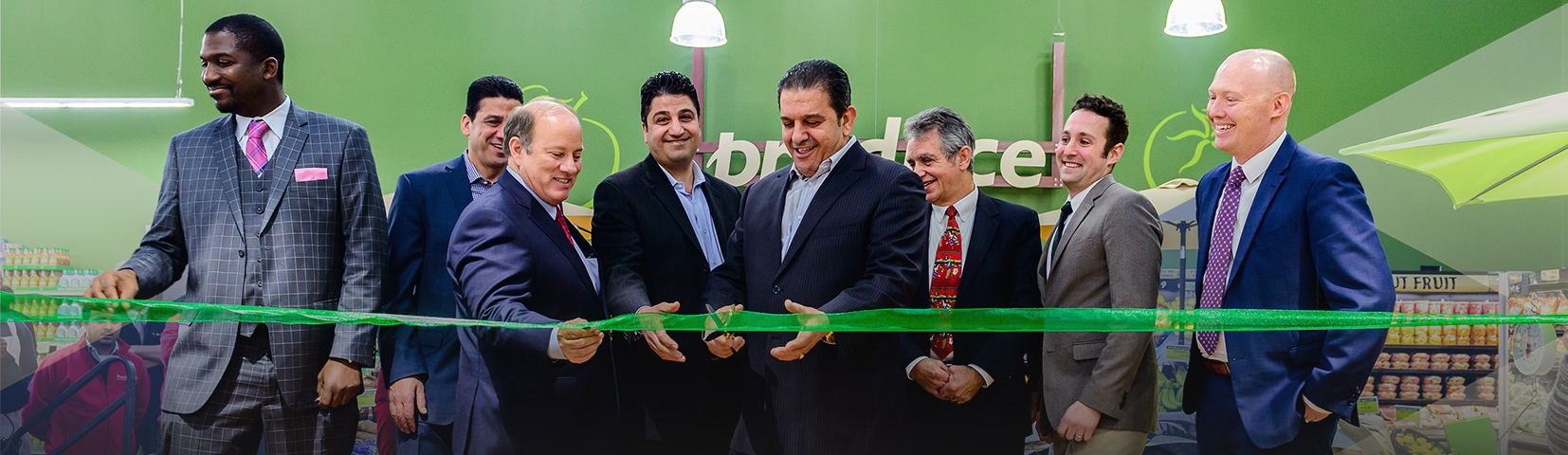 A group of people cut the ribbon at the opening of a project financing by New Markets Tax Credit Allocations