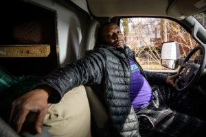 Juan Reid of Tightshift Laboring Cooperative in his van
