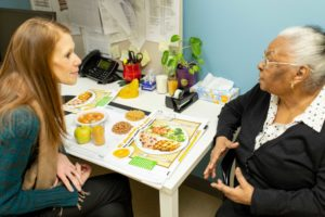 Urban Health Plan nutritionist speaks with a client