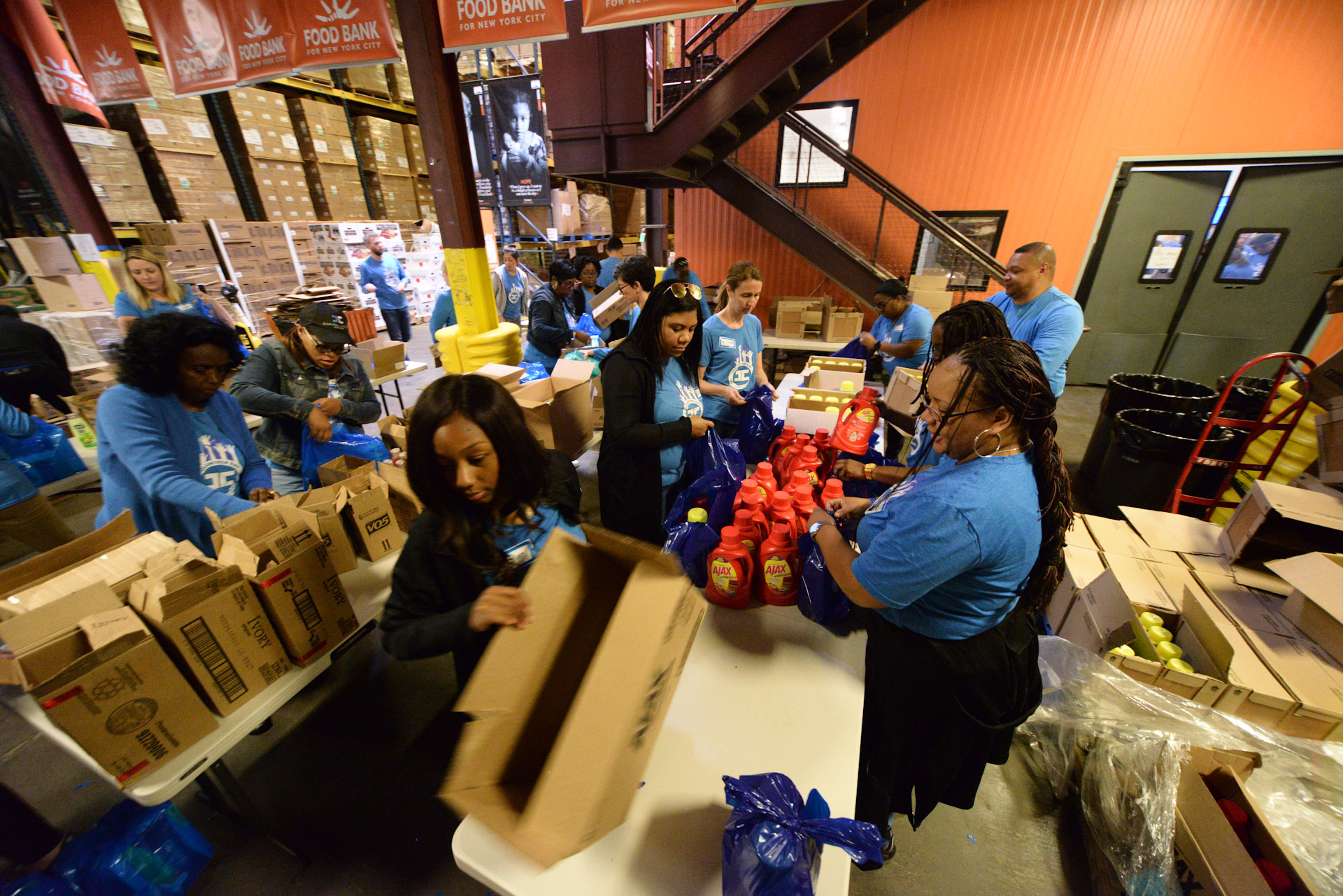 Capital Impact Staff packing items on volunteer day