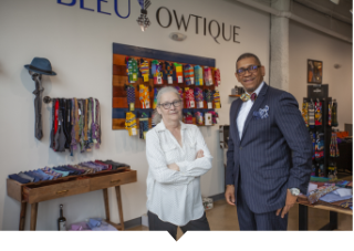 Sue Mosey stands with small business owner in Detroit