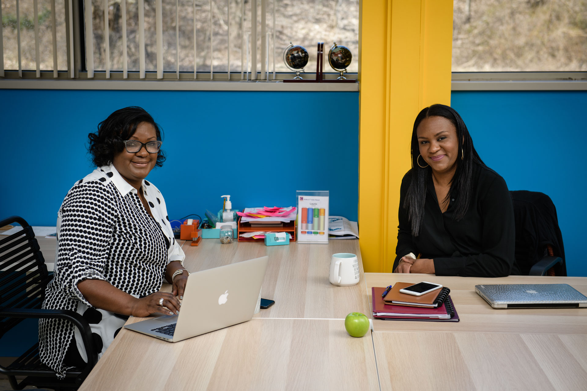 Black female entrepreneurs working at desks