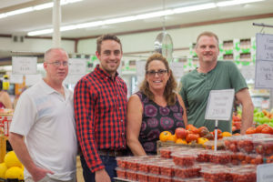 Owners of Ken's Fruit Market in their store