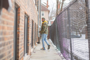 A man walks alongside his apartment building in Detroit