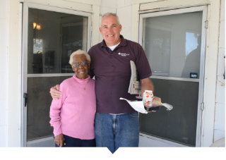 Meals on Wheels volunteer delivers food to a neighbor