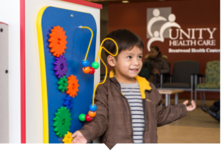 Young boy plays in lobby at Unity Health Care