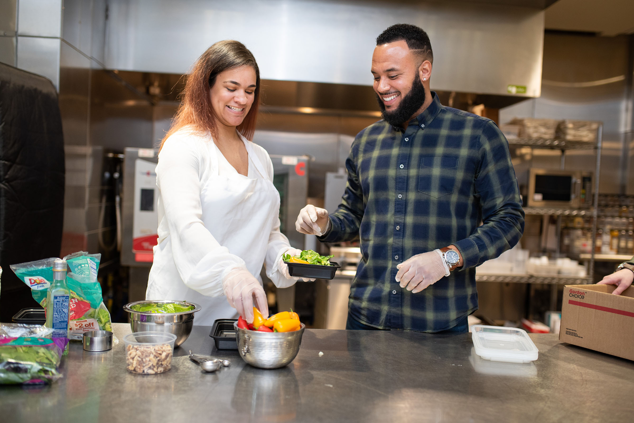 Business owners prepare food in the kitchen