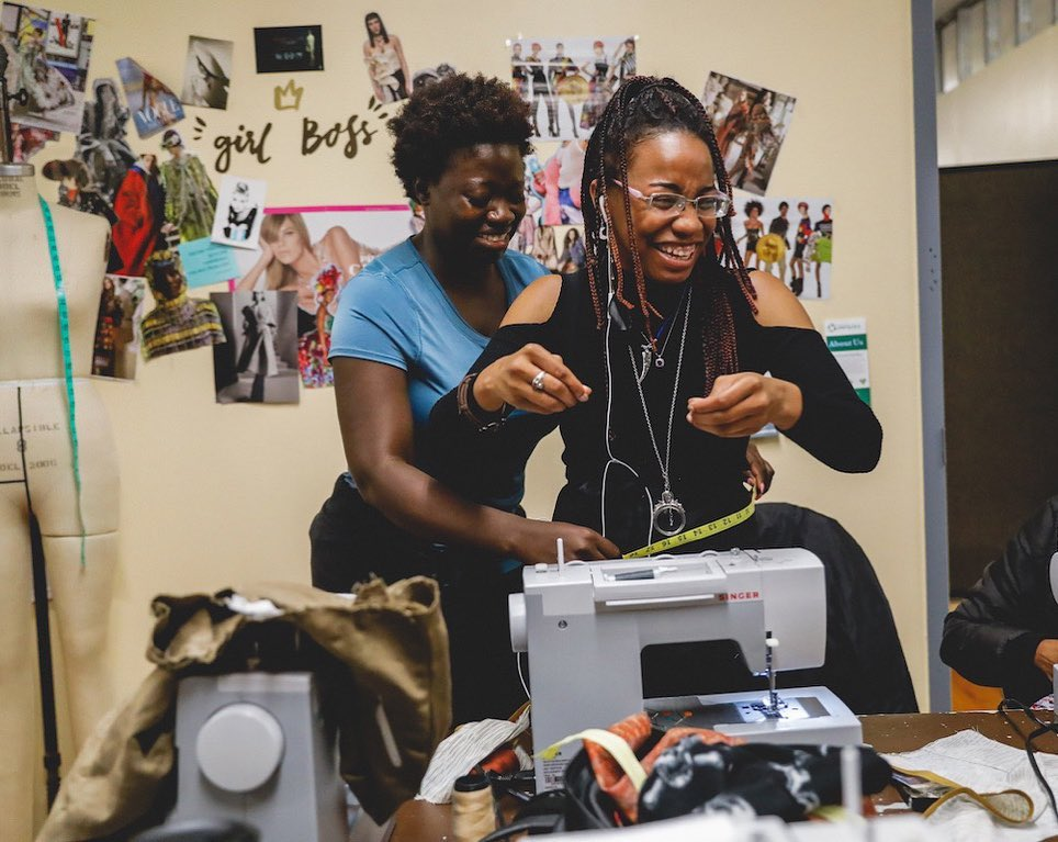 Women of Custom Collaborative work at sewing machines